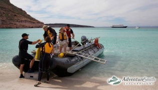 Taking an inflatable ride to shore to go exploreing