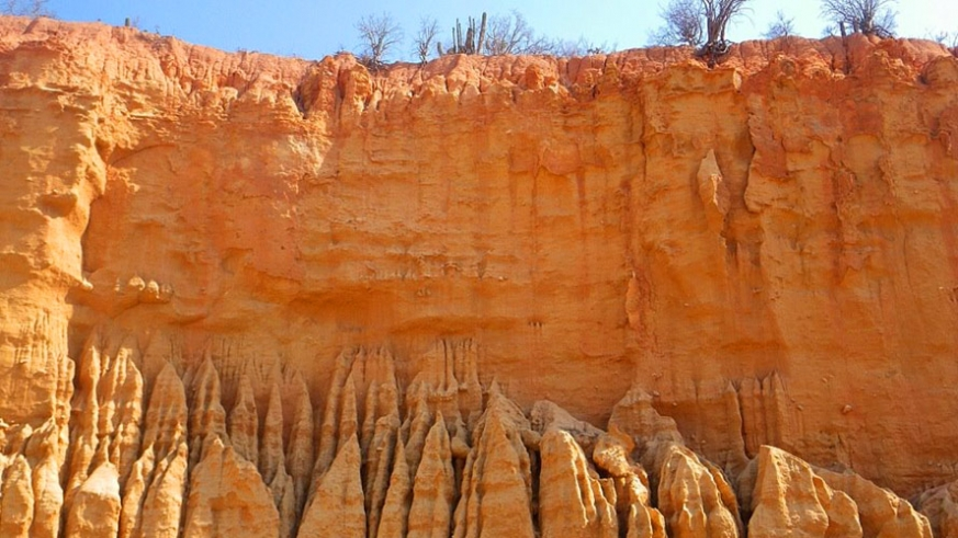 Rock formation of different strata form artworks of color