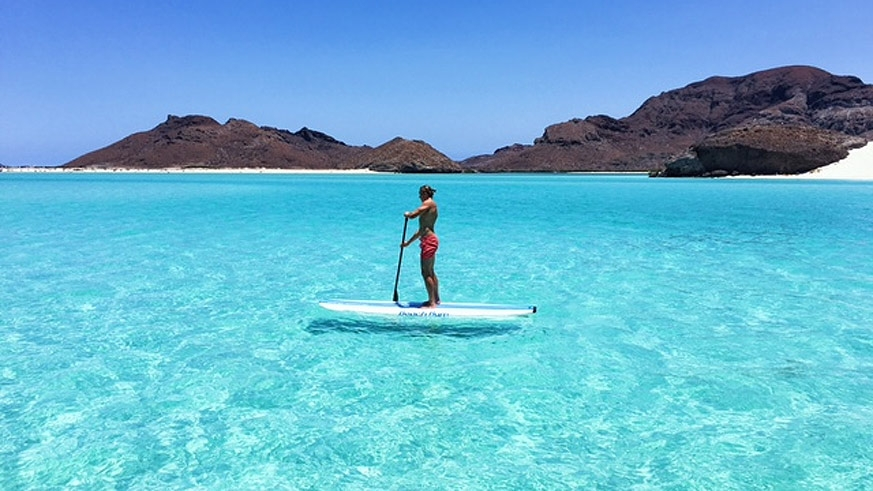 The waters of the Bay of La Paz set a perfect stage for paddle boarding