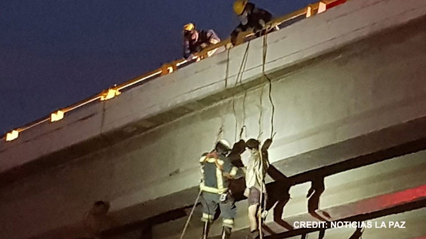 12/20/17 Firefighters remove the second of two bodies found hung to death from a bridge near the La Paz airport. Earlier the same morning two more were found on a Cabo San Lucas overpass and two more on a bridge in San Jose del Cabo
