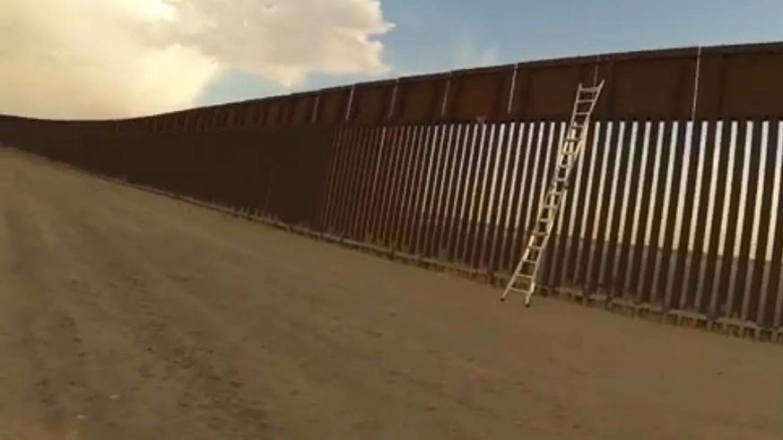 Ladders on border wall