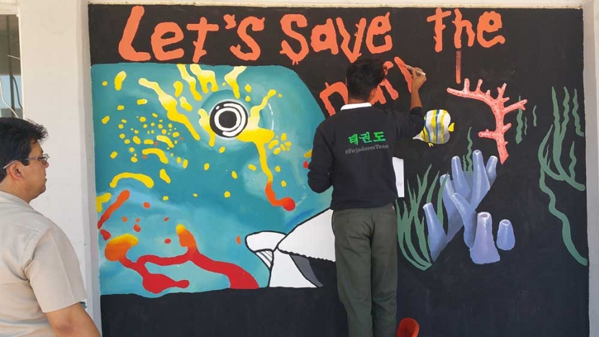 Students painted a mural to illustrate the importance of protecting the parrotfish