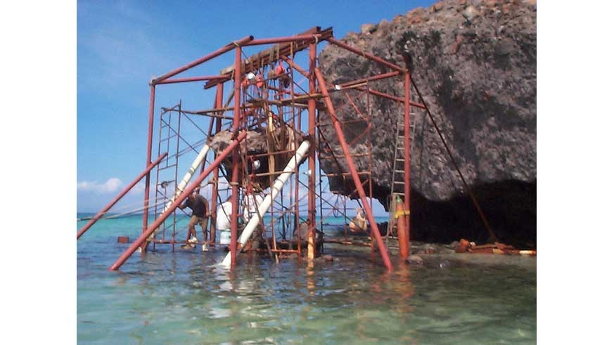 The scaffold erected around Mushroom Rock to reposition it.