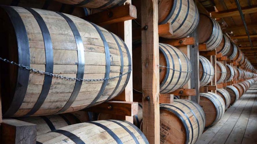 Oak aging barrels in storage racks