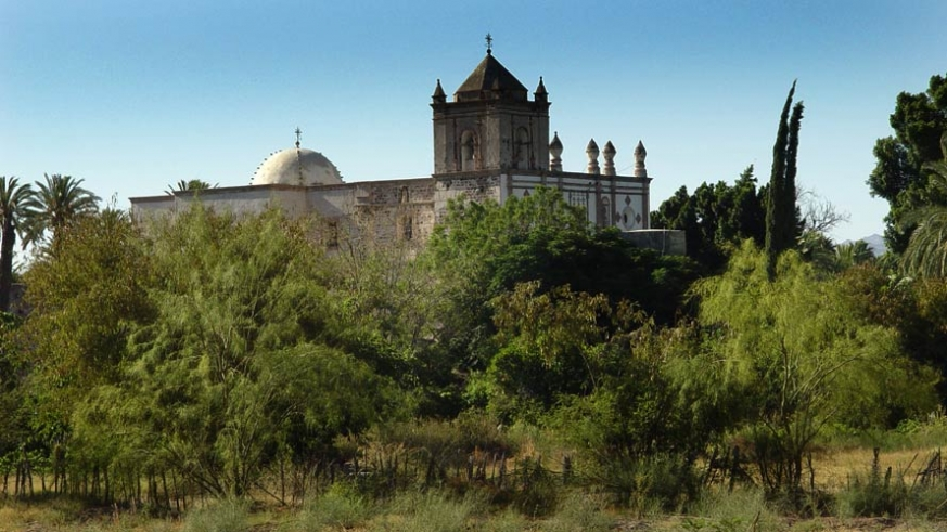 The mission at San Ignacio is visible over the green of the estuaries