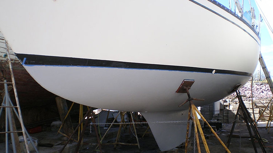 Bottom all primed, ready for bottom paint. In 22 years no significant blistering on this solid hull.