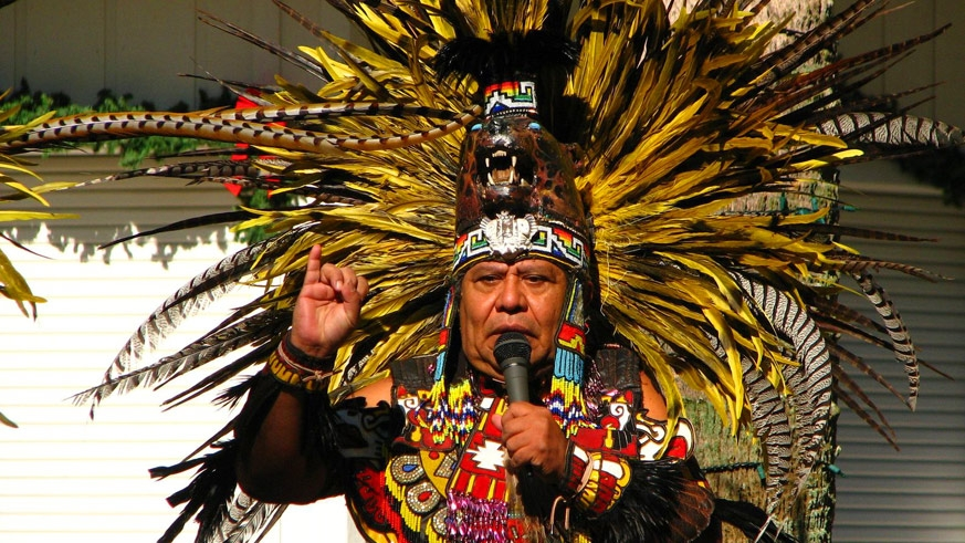 Traditional High Aztec costume with the feathered head dress indicating power or piety